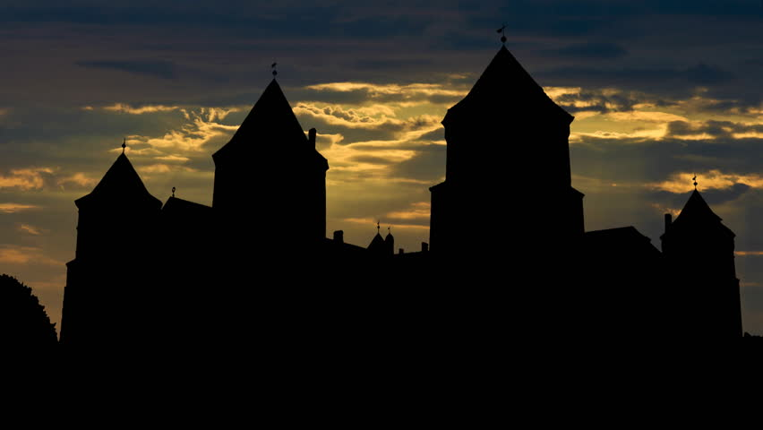 The Mirsky castle in Belarus with starry night and the dawn. The castle was built in the 16th century  and it is listed as the UNESCO world heritage site.   Shutterstock HD Video #1428820