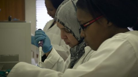 Multi ethnic group of medical researchers working in laboratory.Cape Town,circa November  2015
