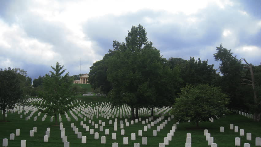 Arlington National Cemetery in Virginia across the Potomac River from Washington D.C. with Arlington House visible. Shot in Time-Lapse.