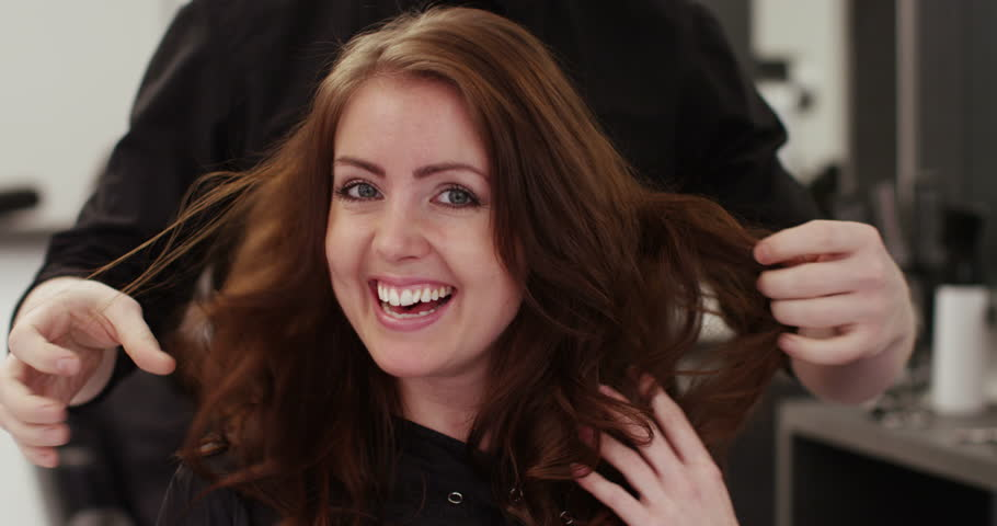 A happy young woman after having her hair groomed at her local salon. Shot on RED Epic.   Shutterstock HD Video #14340118