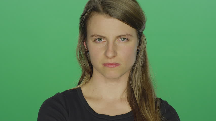 Young women looks upset and shakes her head, on a green screen studio background | Shutterstock HD Video #14361307