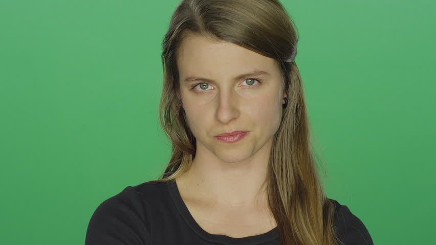 Young women looks upset and shakes her head, on a green screen studio background | Shutterstock HD Video #14361319