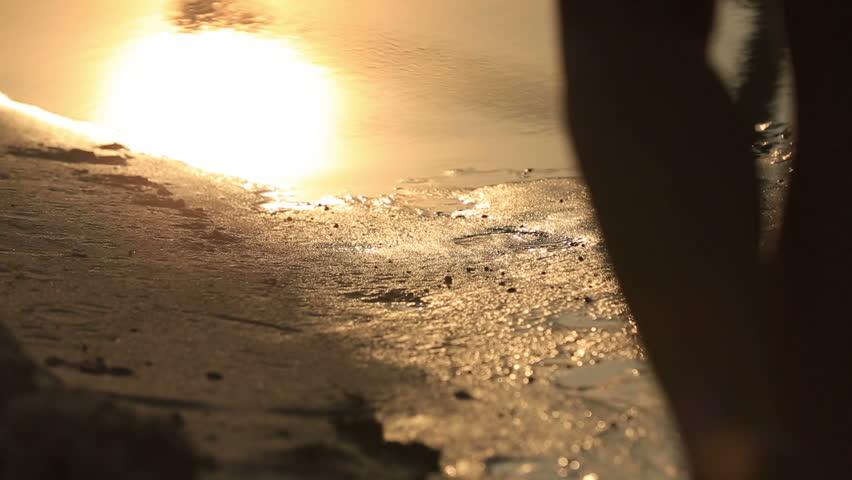 Woman walking on beach barefoot over sunset and enjoying nature.  | Shutterstock HD Video #14361799