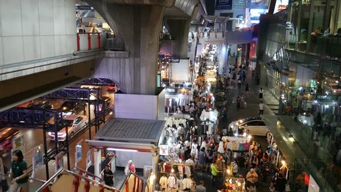 Bangkok, Thailand – January 6, 2016: Night view of the sidewalk near the Siam skytrain station in Bangkok. There are many street vendors selling different things such as fashionable clothes.