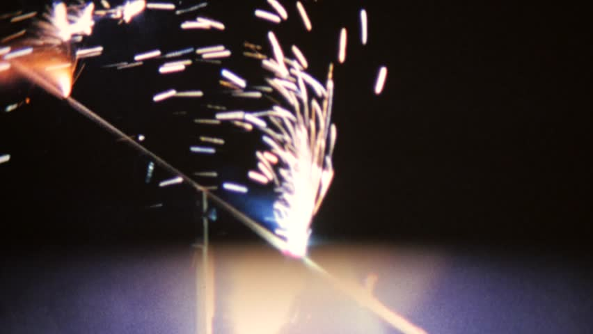 CIRCA 1968: Vintage 8mm film of fireworks with scratches and dust