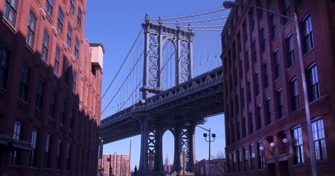 The Iconic Manhattan Bridge Viewed From Dumbo, Brooklyn with the Empire State building framed in the bottom of the bridge. (New York, August 2015)