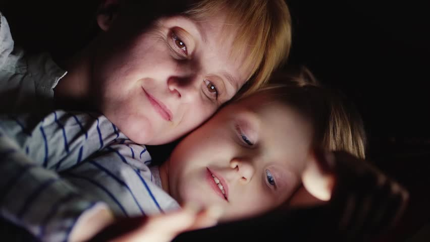 Portrait of a mother and daughter: use tablet | Shutterstock HD Video #14395876