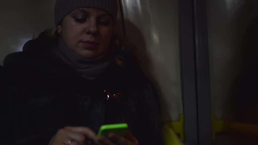 Yong women reading from a smartphone on a bus HD | Shutterstock HD Video #14401783
