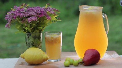 Home made peaches and gooseberry lemonade - stirring the ready lemonade