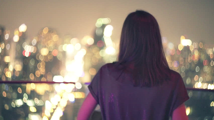 Young woman walking on terrace and admire city view during night  | Shutterstock HD Video #14405668