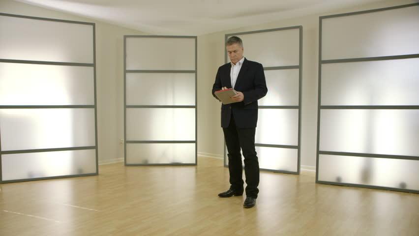 Businessman using a tablet pc in a modern office | Shutterstock HD Video #14455282