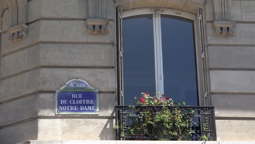 PARIS, FRANCE, JULY 16, 2015 4K Rue Du Cloitre Notre Dame Paris Sign Street Tourists Visiting Cathedral View | Shutterstock HD Video #14457946