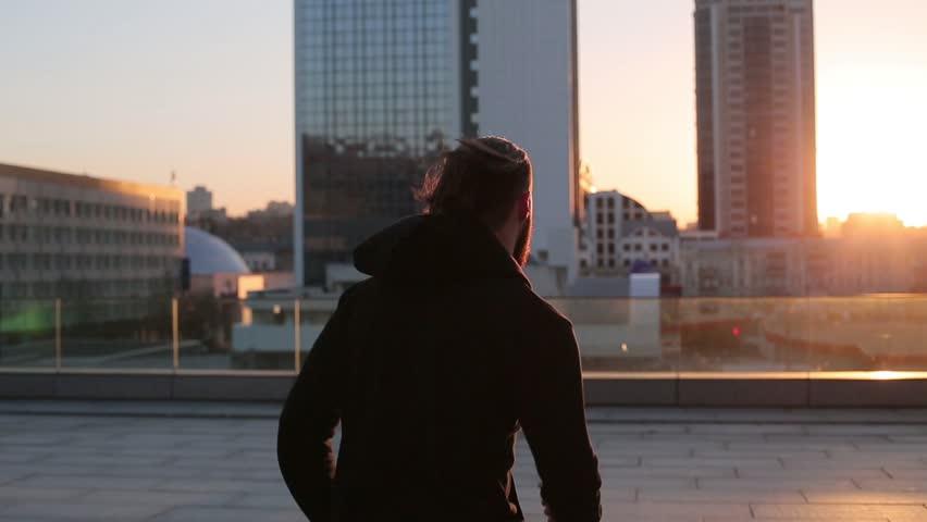 Man running at sunset in city. | Shutterstock HD Video #14471812