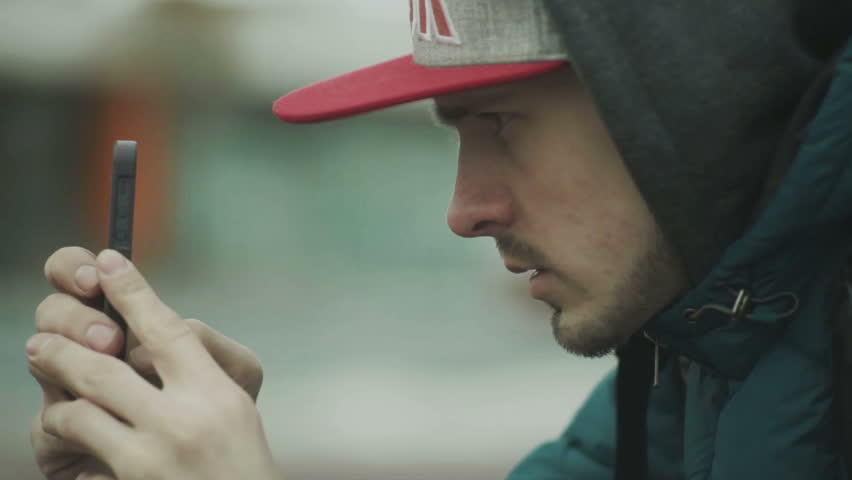 Man photographs on the phone | Shutterstock HD Video #14477254