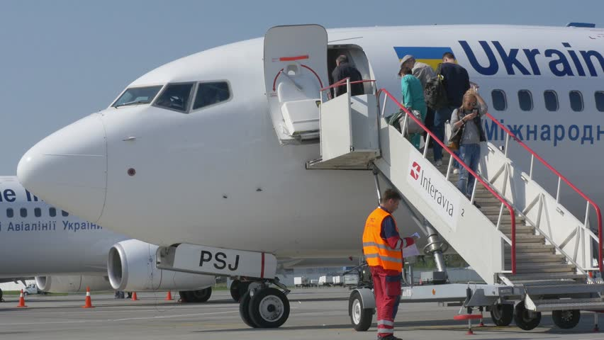 KIEV - MAY 20: Passengers boarding at the airplane Boeing 737 at Boryspil International Airport on May 20, 2015 in Kiev, Ukraine.