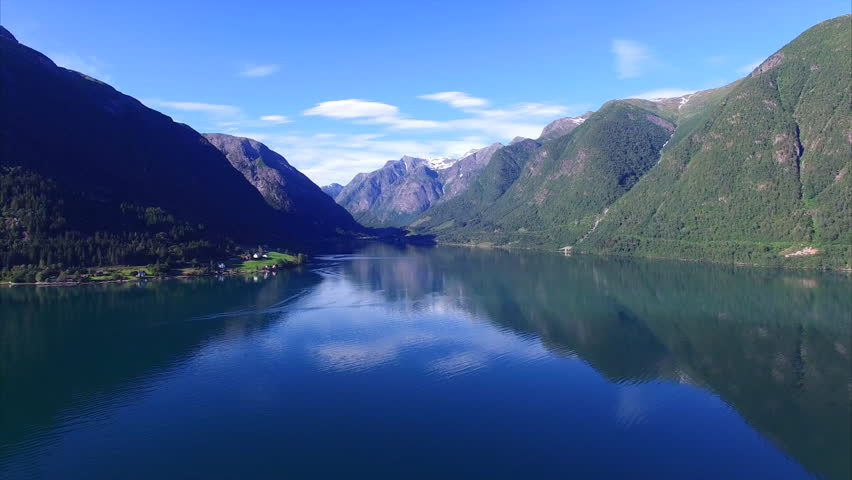 Tranquil scenery of calm fjord with mountains reflecting on the water surface, Sognefjorden in Norway. Aerial 4k Ultra HD.   Shutterstock HD Video #14485825
