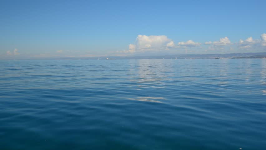 Sea view on the nice summer day. Sea surface close up shot, blue sky with small clouds, clear horizon, nobody. Beautiful summer background for resort and vacation websites. #14487784