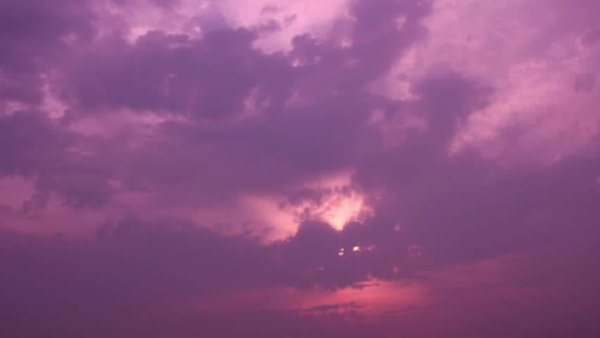 Purple colored cloudscape darkening at sunset sky #14492638