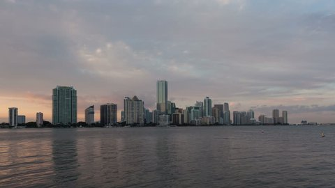 4K zoom in Timelapse Miami city skyline panorama at dusk with urban skyscrapers