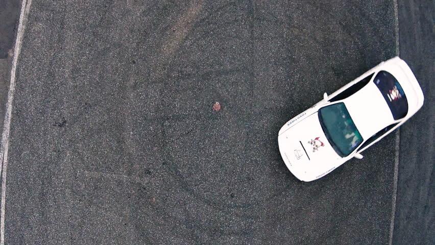 Ariel overhead shot drift sports car in a circle