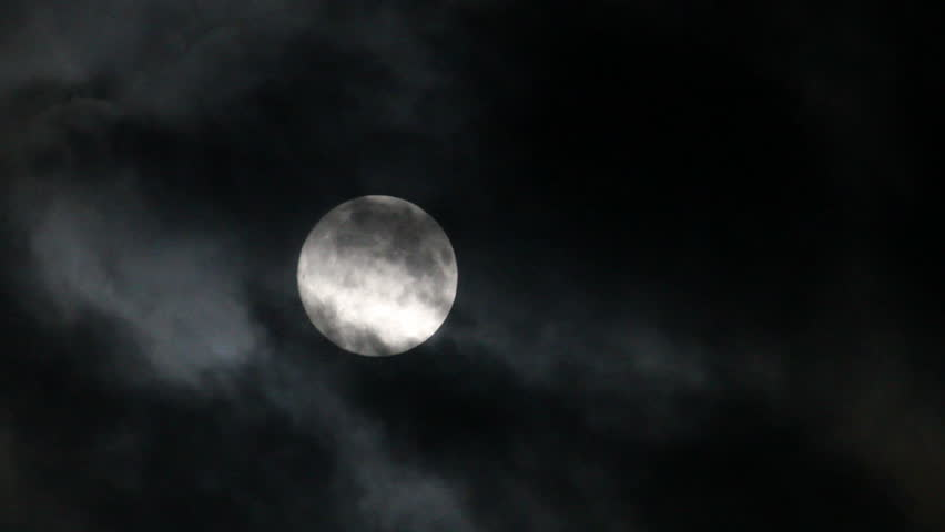 Eerie clouds move over a full moon at night | Shutterstock HD Video #14535676