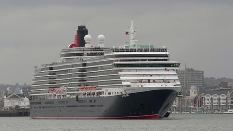 SOUTHAMPTON, UK MAY 03, 2015: Cruise liner 'Queen Victoria', departs her home port. This ship has a gross tonnage of 90,000, is 965 ft long and carries up to 2,014 passengers