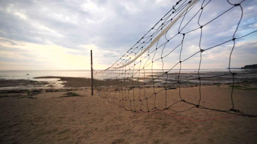 A closeup of volleyball court  divider net.