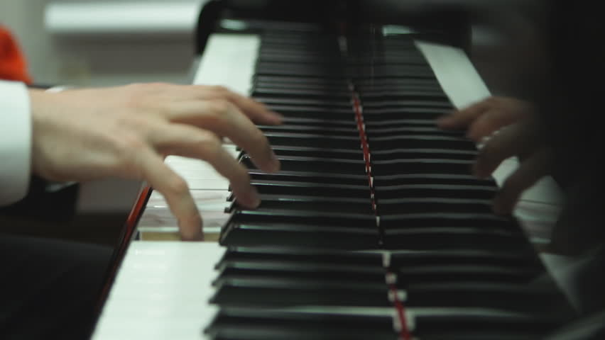 Close up hands playing the piano   Shutterstock HD Video #14566672