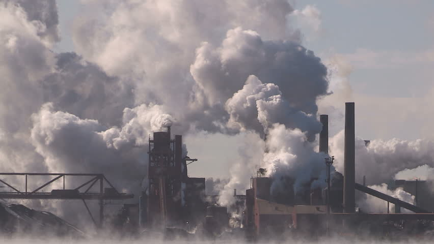 Ontario, Canada February 2016 Clouds of steam and smoke from heavy industry factory and plant