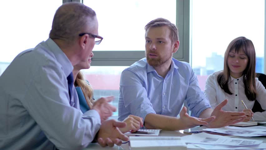 The end of the business meeting. colleagues shaking hands | Shutterstock HD Video #14588875