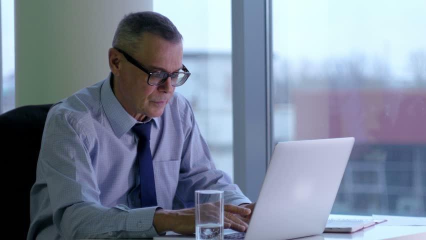 Elderly businessman working with computer in modern office   Shutterstock HD Video #14588977