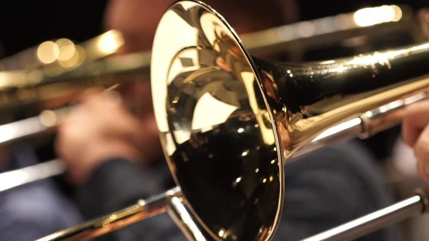Jazzman playing trumpet close-up