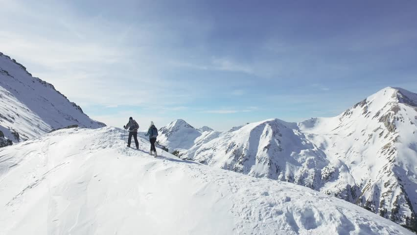 Man Woman Couple Hiking Climbing Mountain Slope Winter Vacation Exploration Expedition Snow Peak Adventure Success Danger Extreme Nature Concept