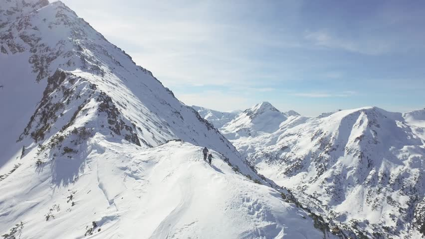 Woman Man Walking Hiking Outdoors Winter Mountain Range Aerial Alps Beautiful Snow Nature Vacation Concept