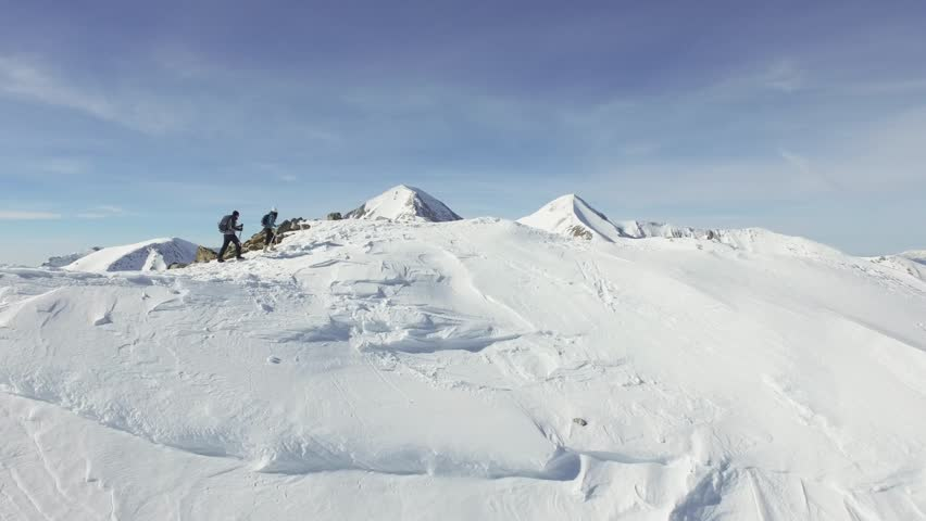 Epic Beautiful Mountain Range Couple Hiking Expedition Alps Aerial Drone Footage Ski Extreme Sports Dangerous Environment Concept