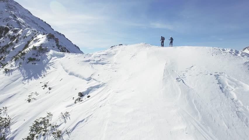 Man Woman Climbers Walking Up Winter Snow Mountain Slope Climbing Toward Peak Success Pursuit Challenge Exploration Everest Expedition Concept
