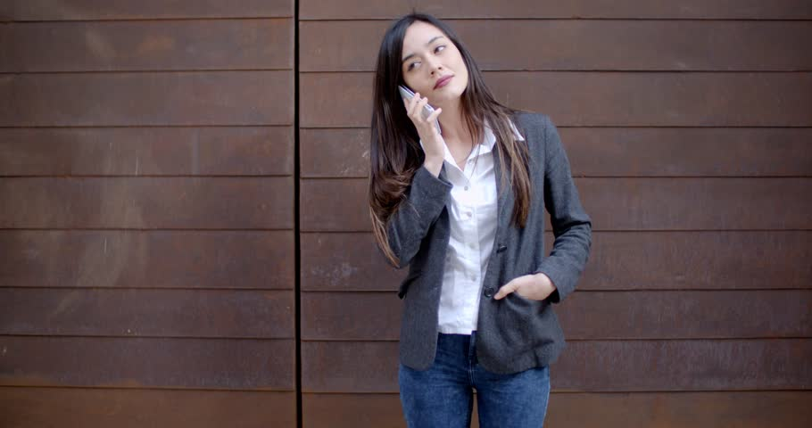 Casual relaxed young woman talking on a mobile   Shutterstock HD Video #14598520
