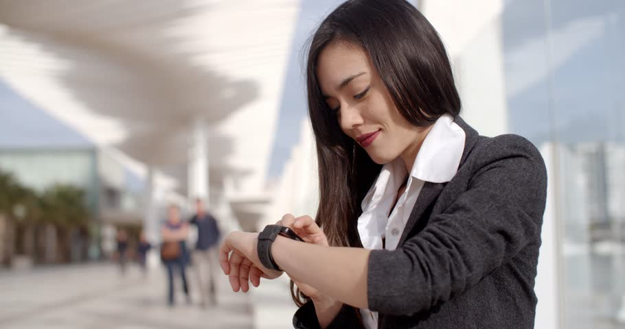 Attractive woman checking the time | Shutterstock HD Video #14598544