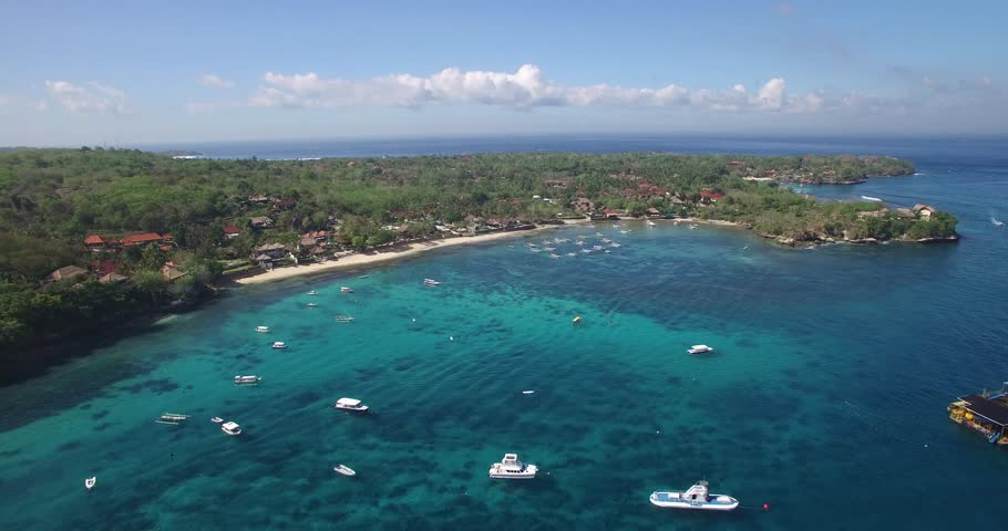 4K AERIAL FLY OVER OF CRYSTAL CLEAR OCEAN, BEACH AND BOATS BELOW | Shutterstock HD Video #14599420