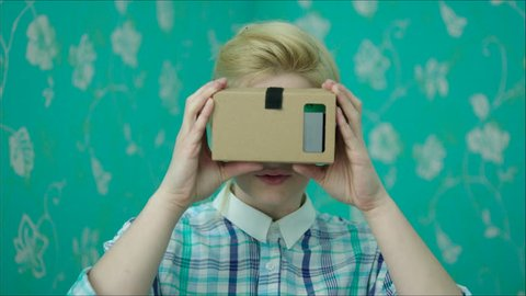 Young Woman Is Happy in Virtual Reality Glasses. VR. Google cardboard