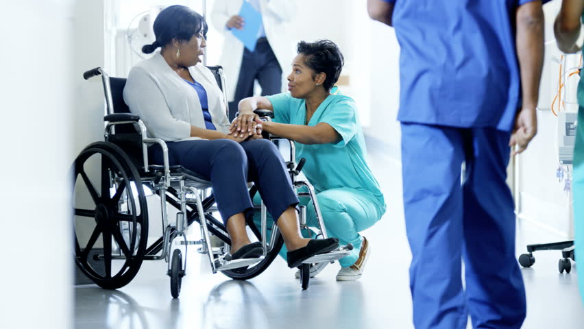 African American empathy female staff and disabled patient consult in hospital