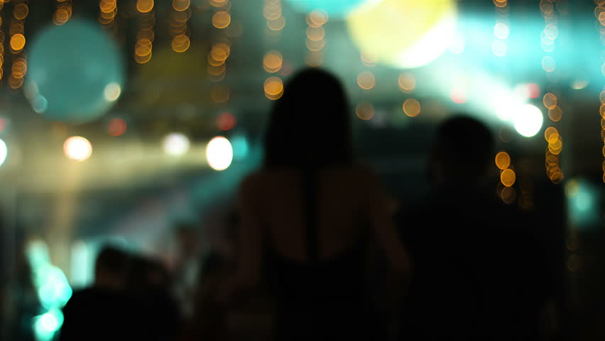 Blurred footage with young attractive people dancing in a nightclub. Girl dancing back to camera. | Shutterstock HD Video #14615884