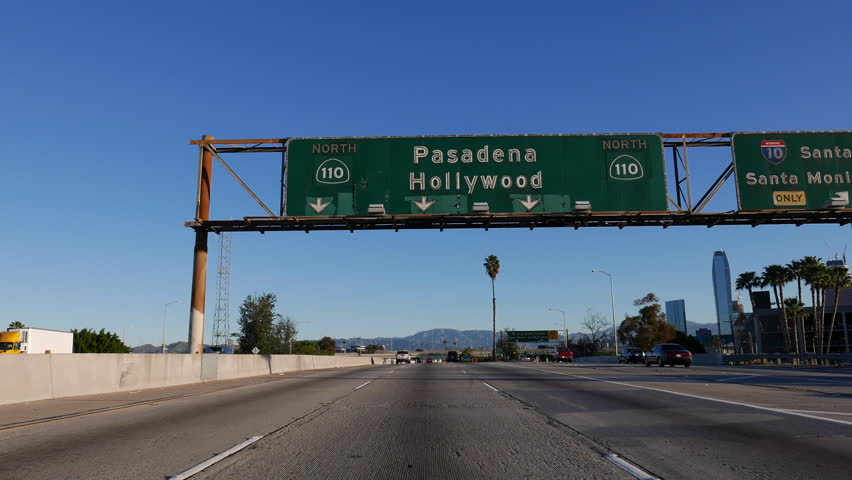 LOS ANGELES, CALIFORNIA, USA - February 7, 2016:  Pasadena and Hollywood 110 freeway sign in downtown Los Angeles. | Shutterstock HD Video #14619238