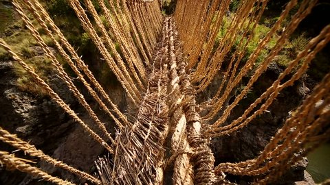 video clip of the Inka grass bridge Q'Eswachaka over the river Apurimac in Andes of Peru near Huinchiri (near Cusco). The Inca bridge needs to be renovated every year and is one of the last existing