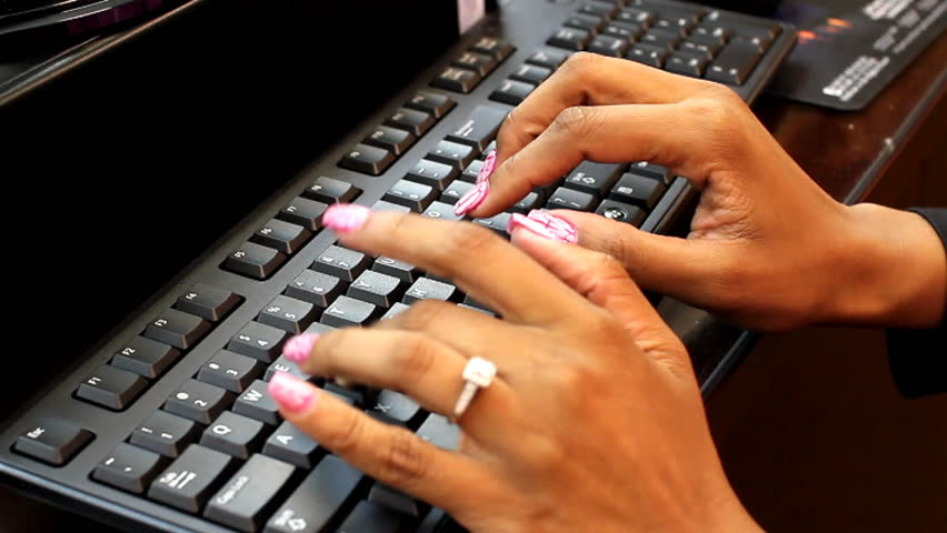 African American woman typing on computer keyboard | Shutterstock HD Video #14695672