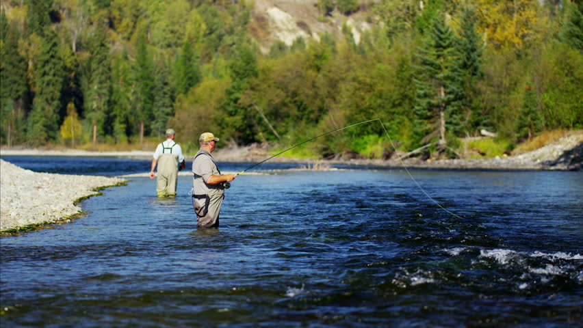 American fisherman wading in Wilderness river fly fishing USA | Shutterstock HD Video #14711611