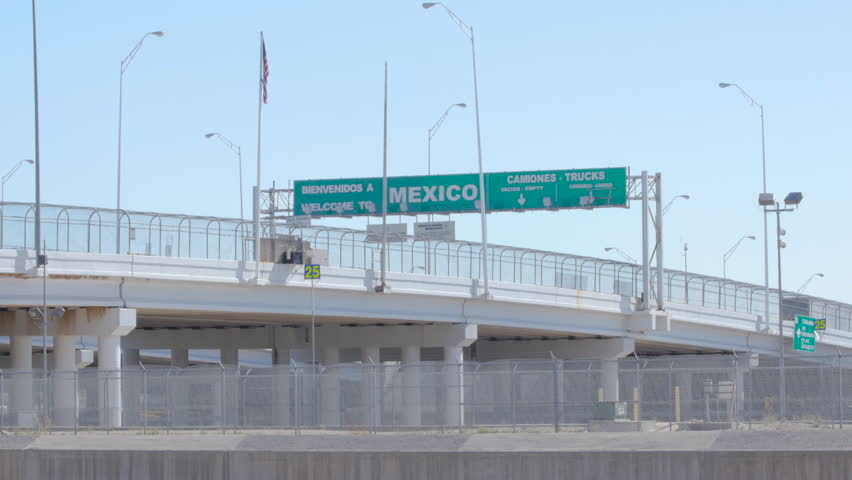 Wide shot of traffic driving toward the Mexican border.