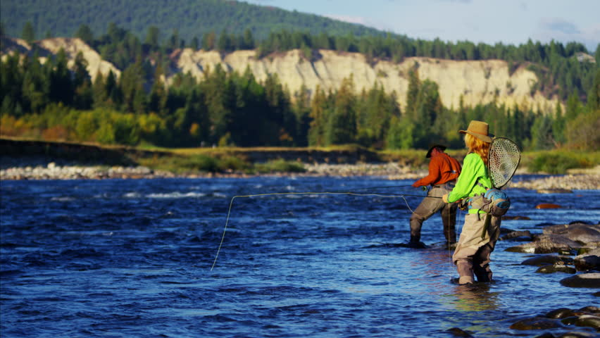 Male female rod and reel fly fishing in freshwater river #14716210