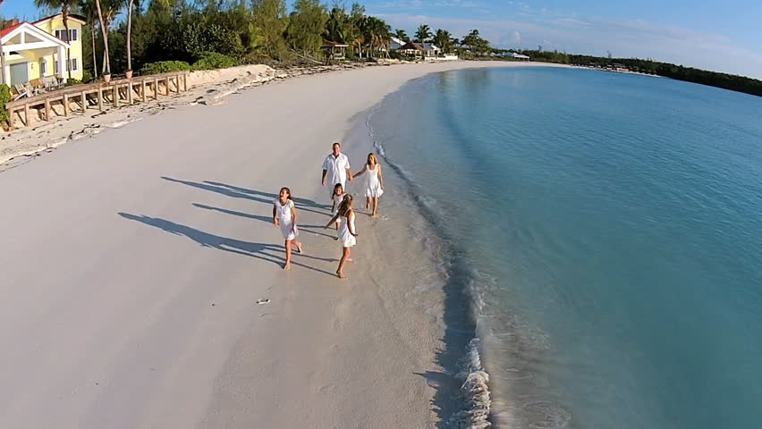 Aerial drone Caucasian family walking together on beach holiday | Shutterstock HD Video #14721949
