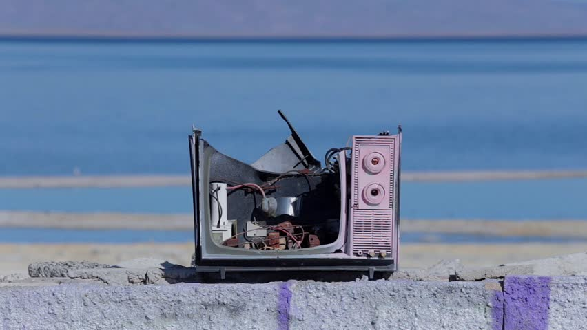 Broken TV At Water / Broken TV with the water and some bird flying behind it. | Shutterstock HD Video #14722813